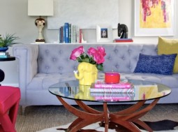 tufted couch with mid-century modern coffee table