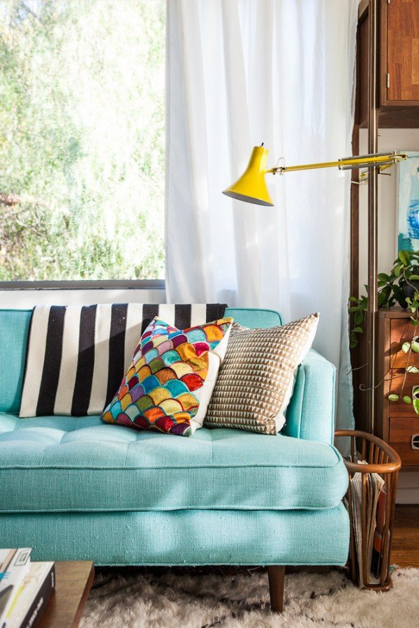 teal sofa, yellow lamp, bri emery's house