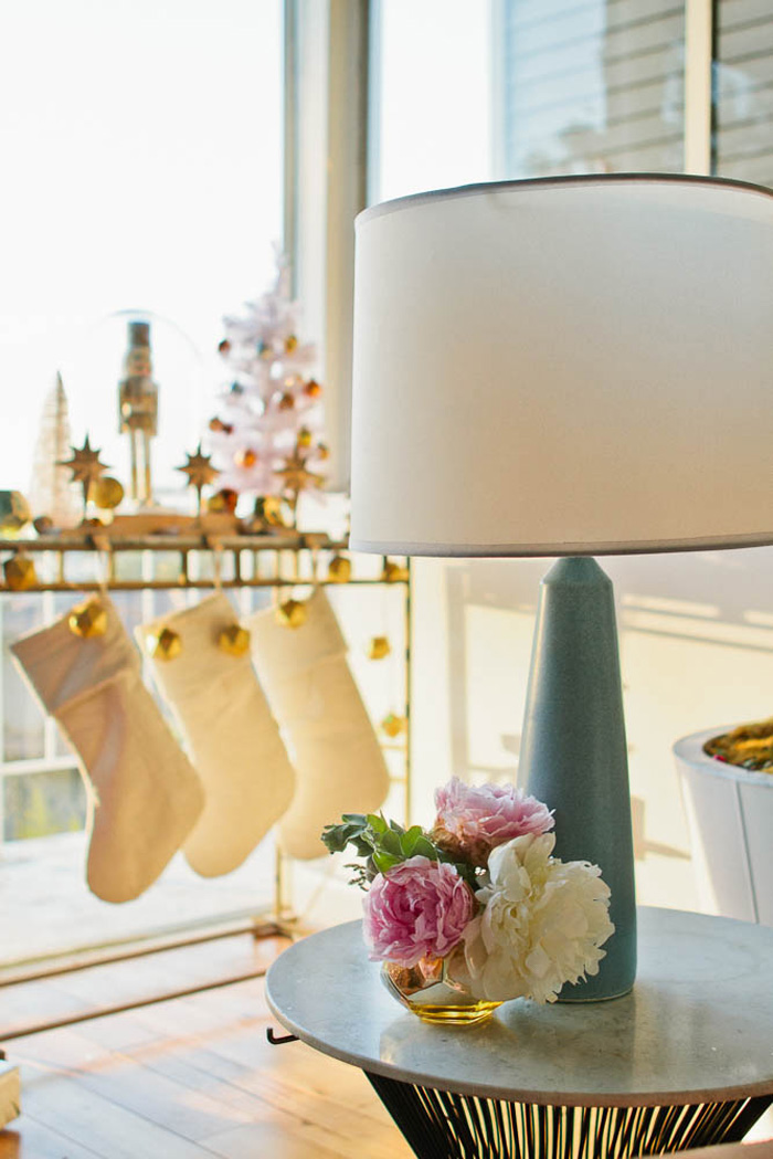 Emily Henderson Holiday Decorating Copper Gold Blue Entry Table Stockings
