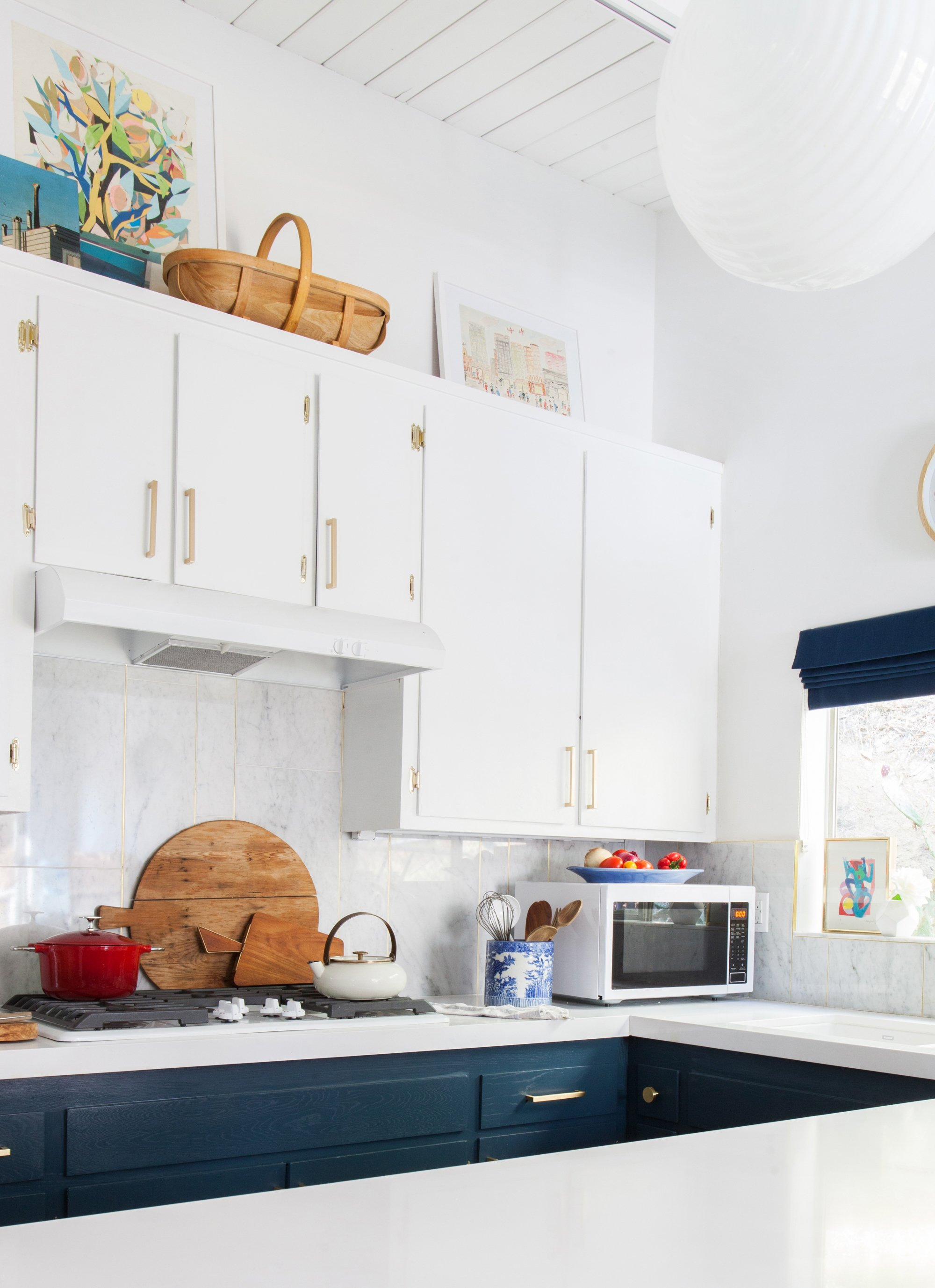 kitchen_after_emily henderson blue white brass countertops cabinets