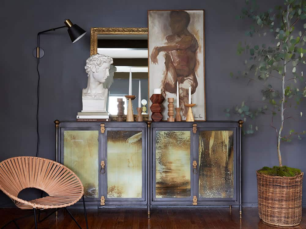 brady tolbert_credenza_moody living room_swing arm sconce_masculine_modern_grey paint_kendall charcoal_bust cb2 swing arm brass wall