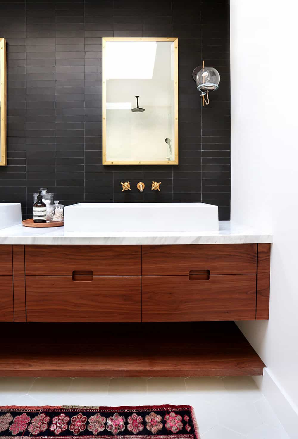 black-tile-bathroom-grout-color-and-penny-tiles-and-subway-tiles-emily-henderson-design