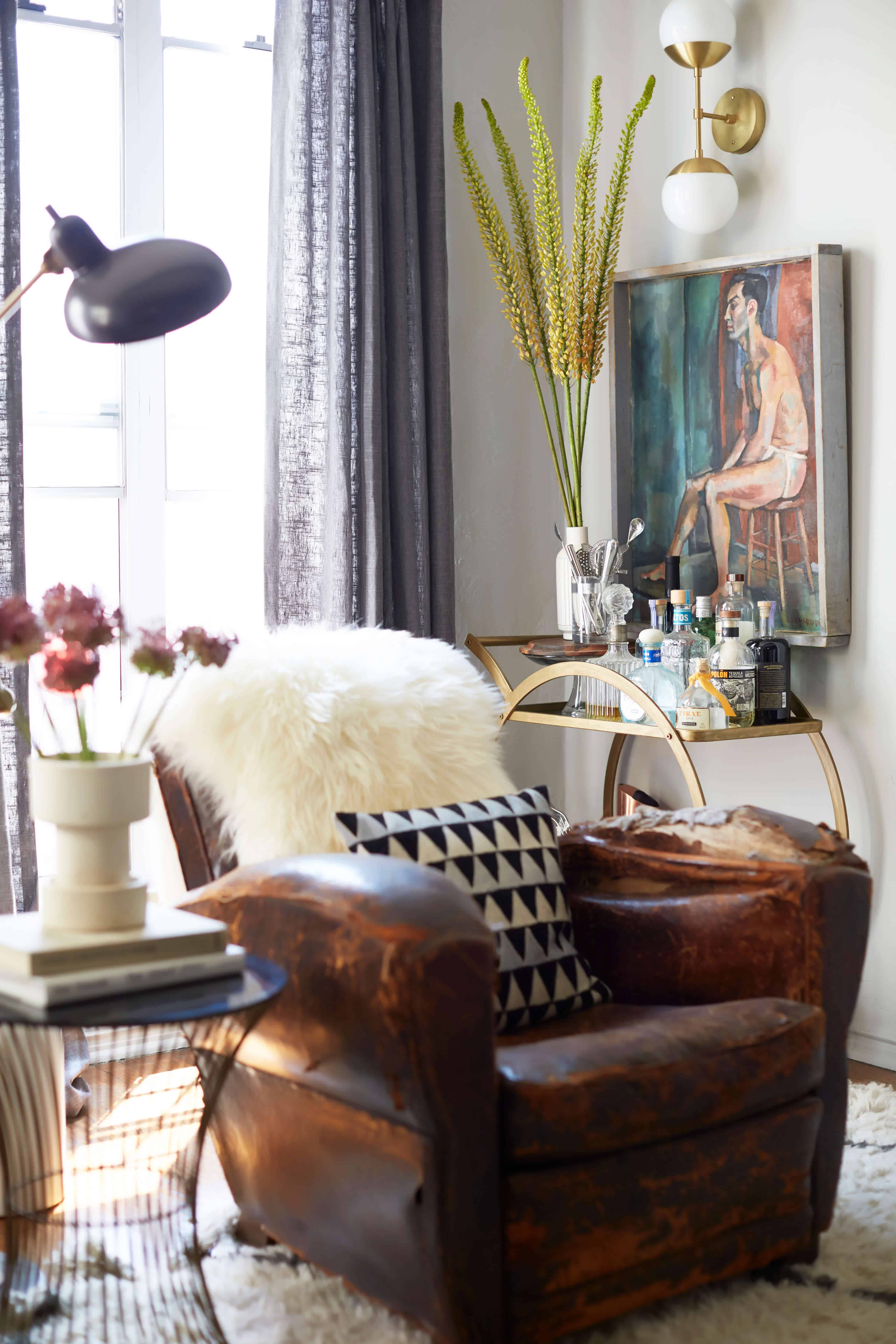 brady-tolbert-design_emily-henderson_living-room_eclectic_pavillion-grey_farrow-and-ball_brass-coffee-table_english-roll-arm_albini_masculine_traditional_west-elm_souk_flokati_leather_13