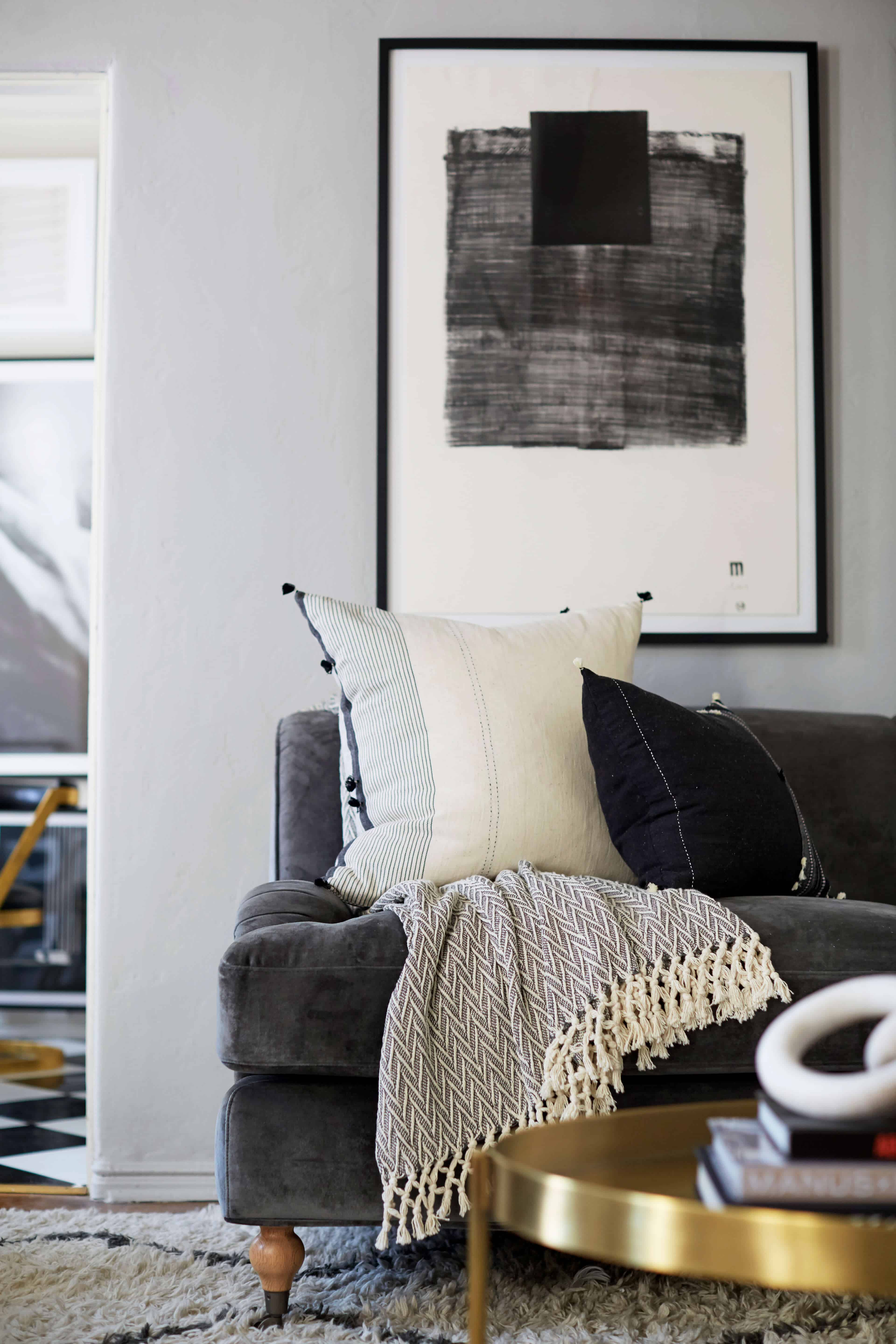 brady-tolbert-design_emily-henderson_living-room_eclectic_pavillion-grey_farrow-and-ball_brass-coffee-table_english-roll-arm_albini_masculine_traditional_west-elm_souk_flokati_leather_17