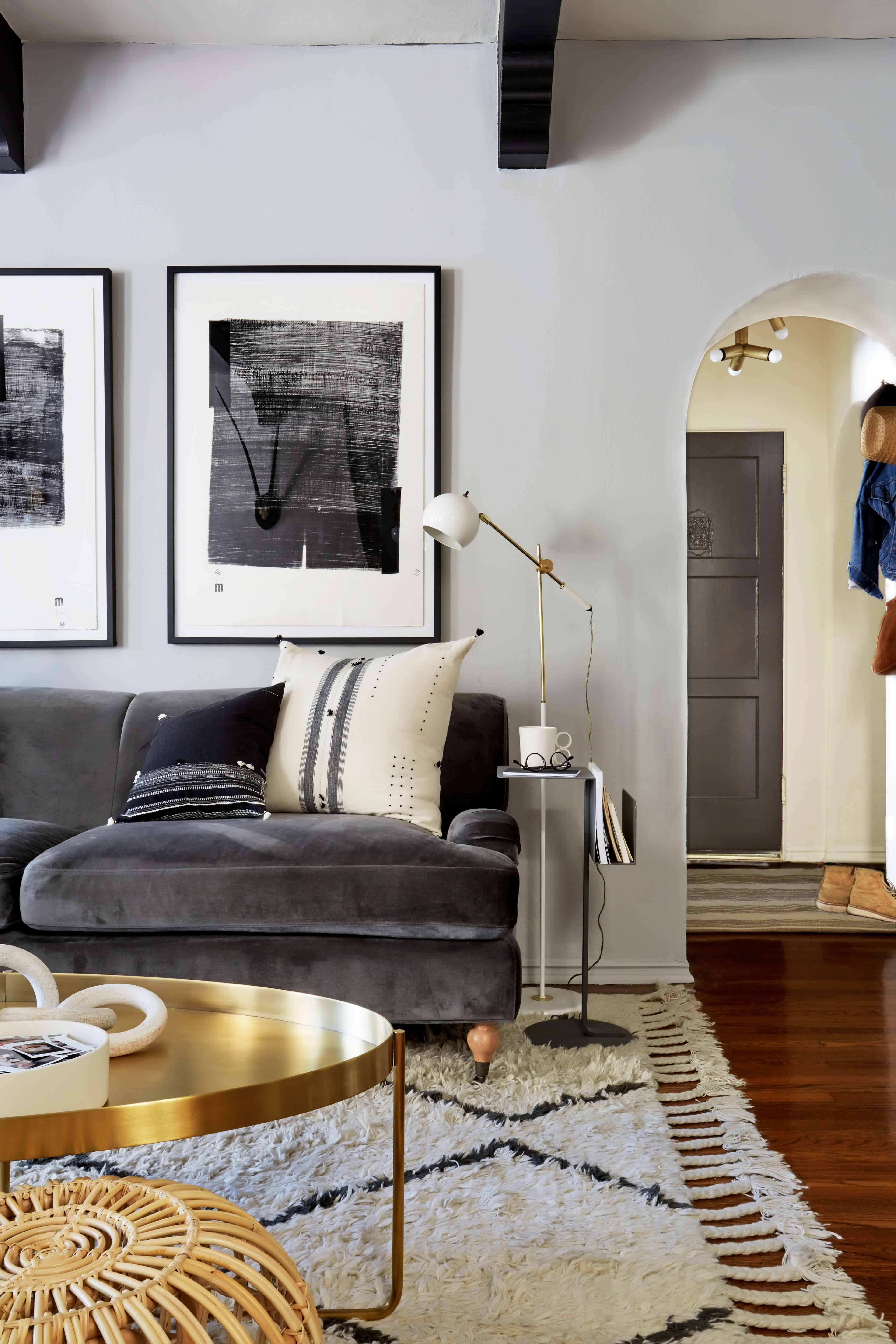 brady-tolbert-design_emily-henderson_living-room_eclectic_pavillion-grey_farrow-and-ball_brass-coffee-table_english-roll-arm_albini_masculine_traditional_west-elm_souk_flokati_leather_2