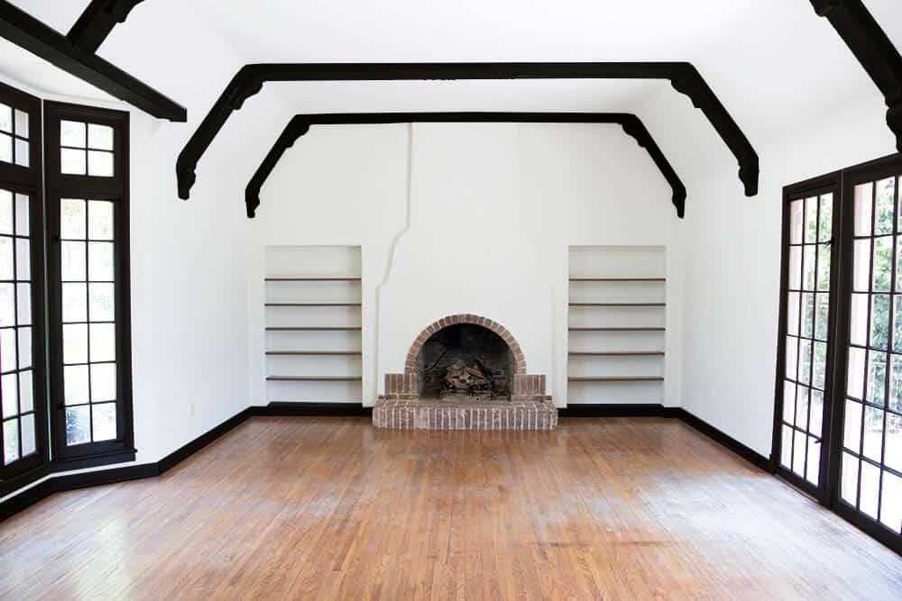 all-black-living-room-emily-henderson_house_living-room_painting_trimwork_white-walls-black-baseboards-black-trim-and-black-beams
