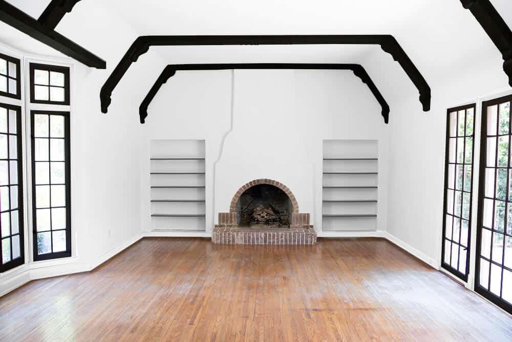 white-frames-black-windows-living-roomemily-henderson_house_living-room_painting_trimwork_white_with-black-mullions_1