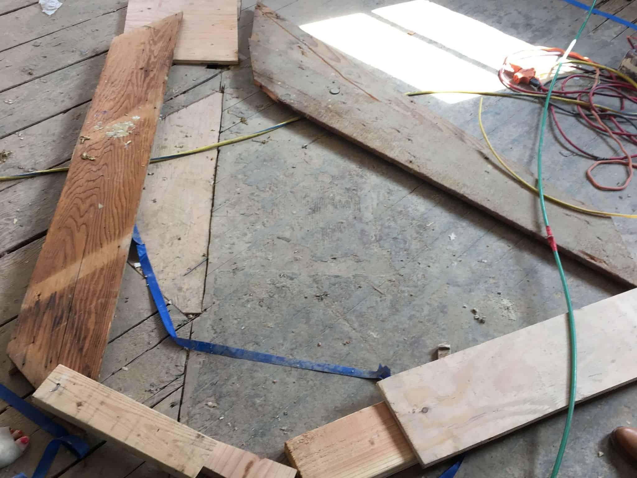 progress_kitchen_demo_floor-demo_island-roughed-out_wood-on-floor