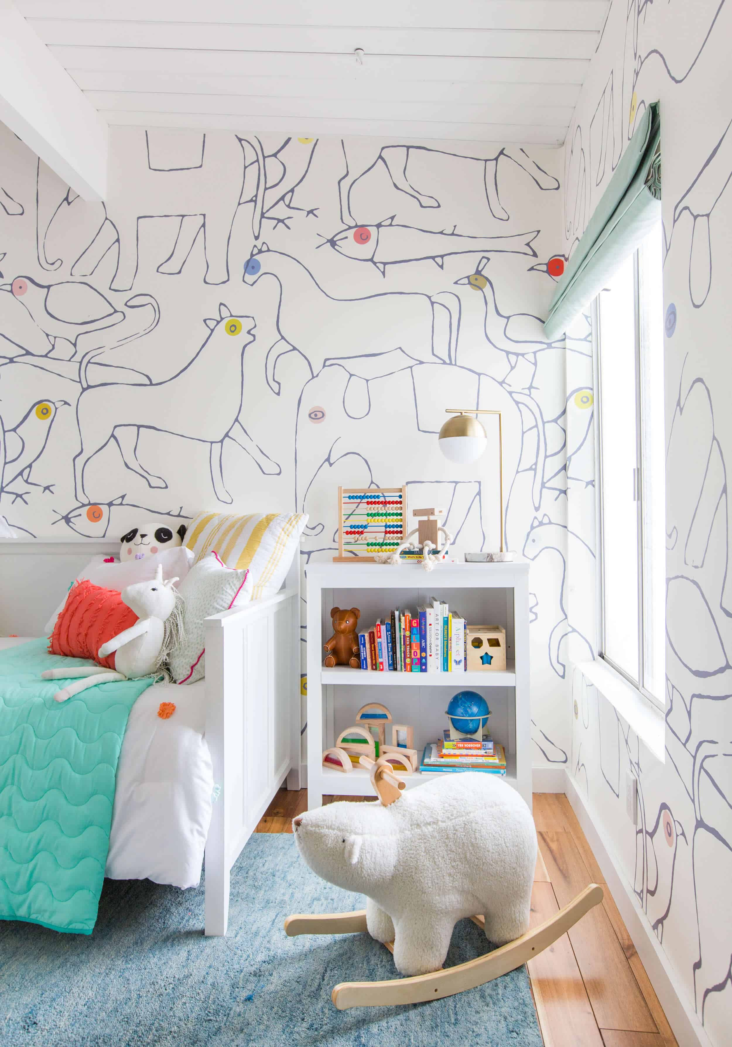 emily-henderson_kids-room_target_bedding_layered_light_texture_blue_white_brass_nursery_girls-room_bright_11