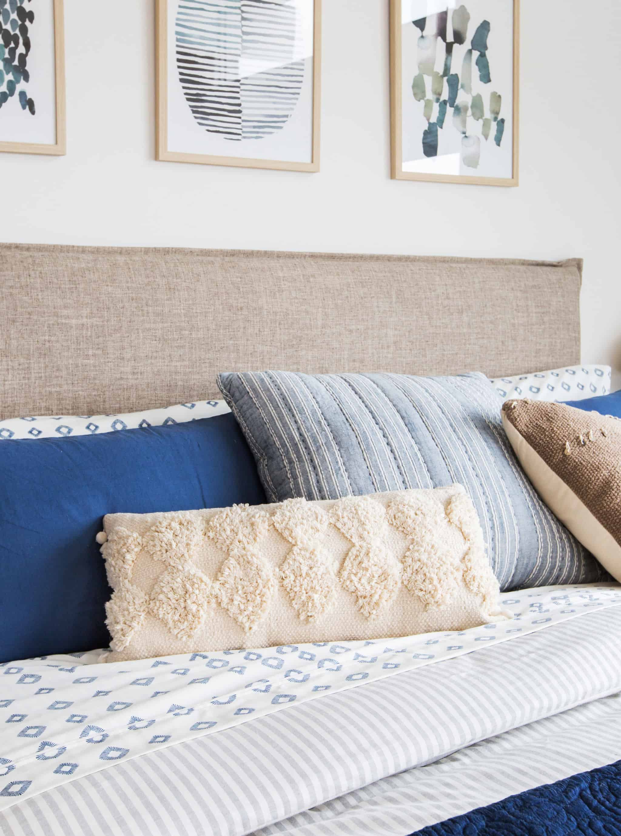 emily-henderson_master-bedroom_target_bedding_layered_light_texture_blue_white_brass_masculine_soft_5