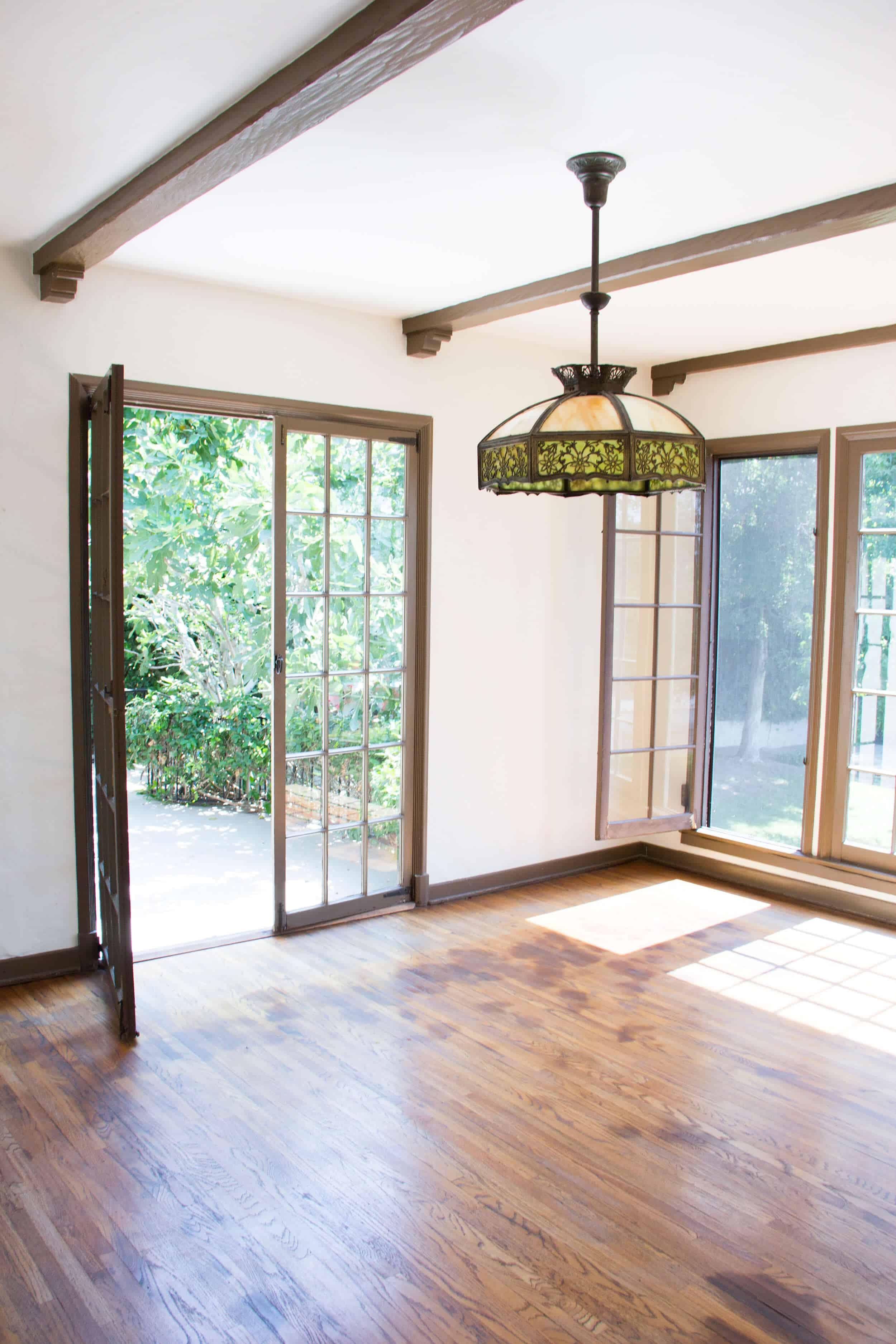 Emily Henderson_Waverly_BEFORE_Wood_Floor _Dining Room Windows