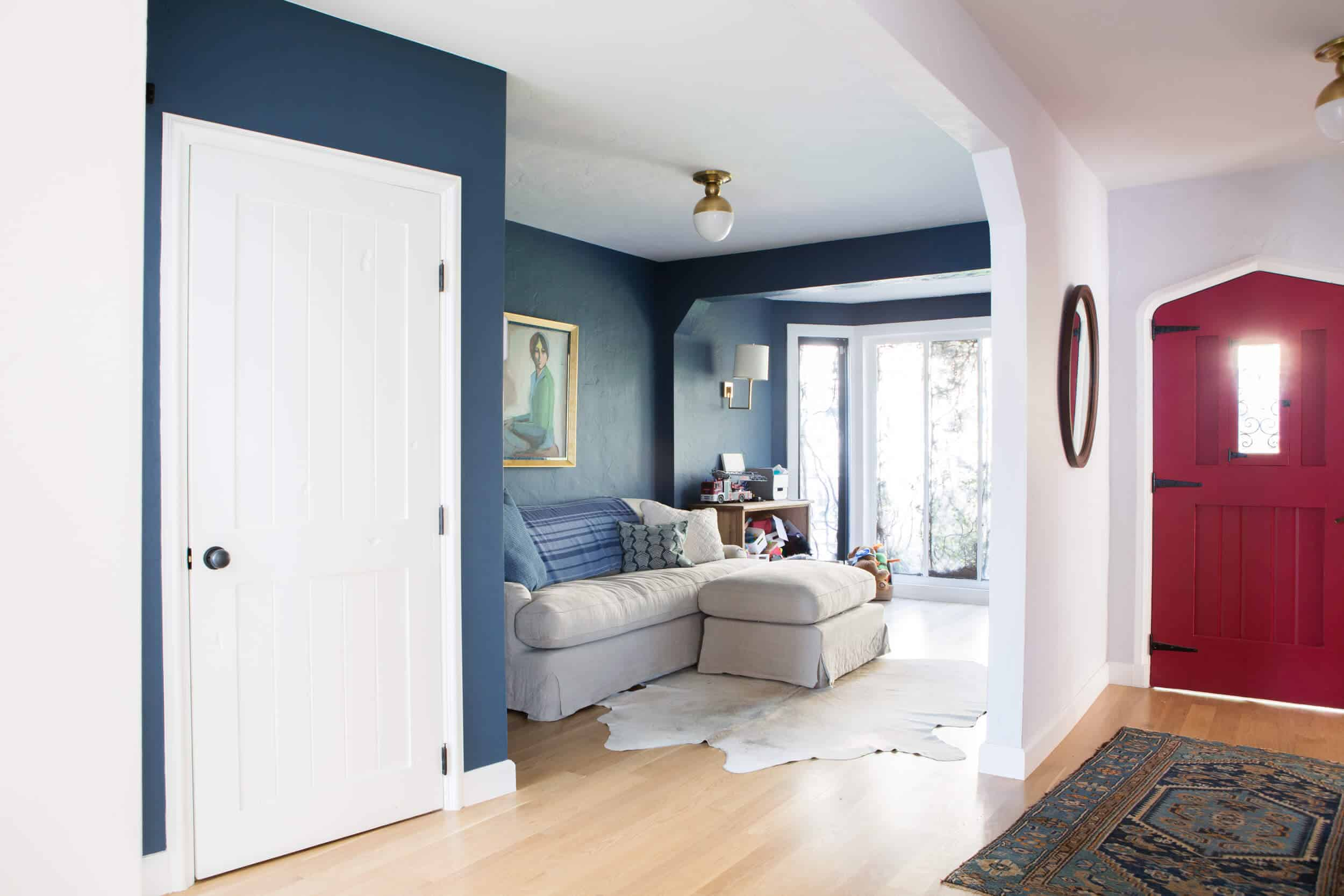 Emily-Henderson_New-House_Modern-English-Cottage_Updates_Family-Room_Blue-Paint-with-Sofa_1