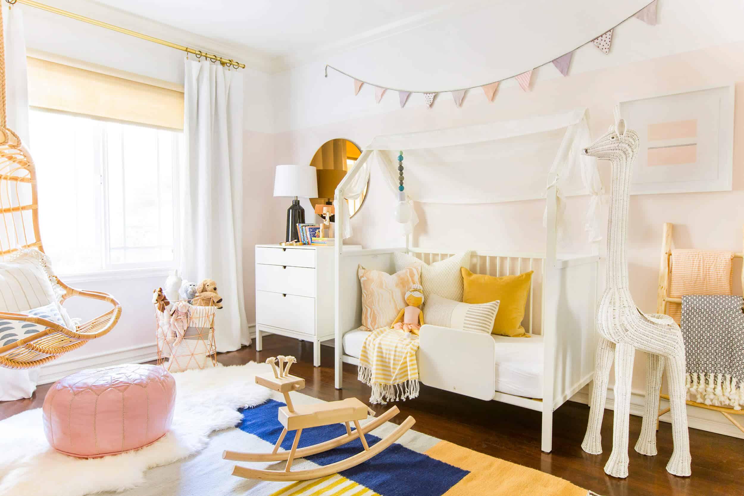 Emily Henderson Brady Tolbert Stokke Home Nursery Kids Room Pink Boho Scandinavian Modern White Pink Blush Room 8