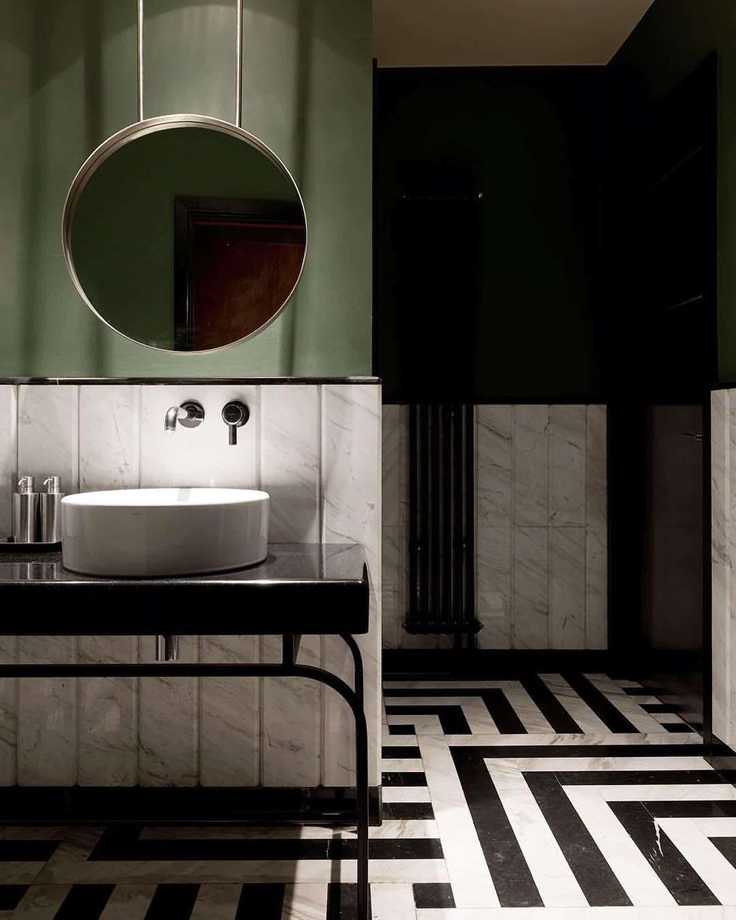 green bathroom modern black and white tile floors