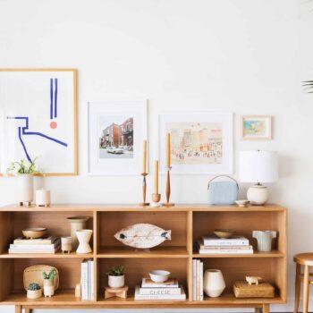 neutral living room bookshelf ceramic pottery