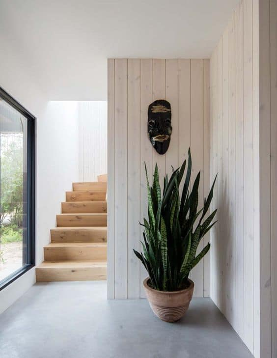 White Washed Wood Hallway With Stairs