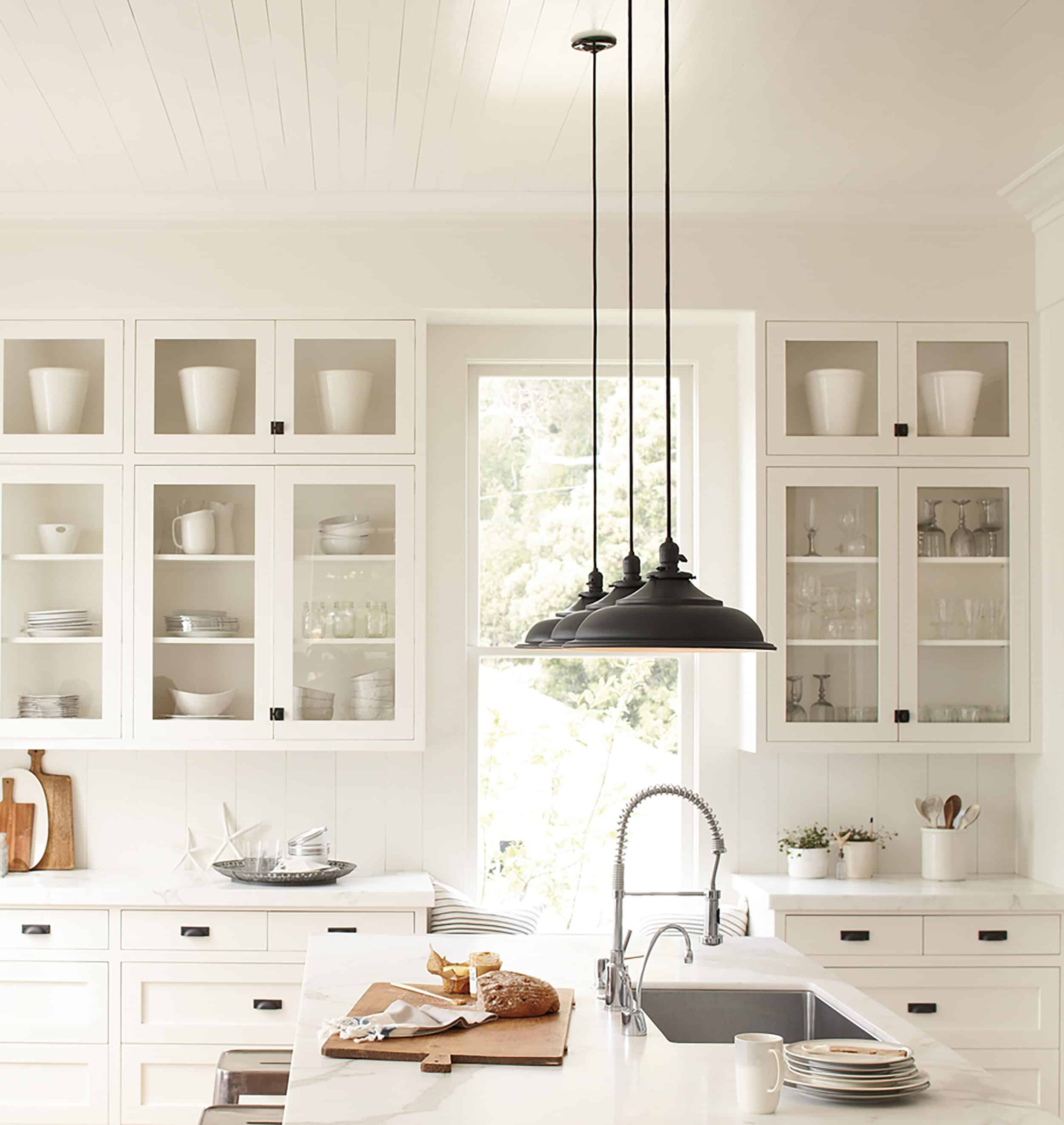 White Farmhouse Kitchen With Glass Cabinets