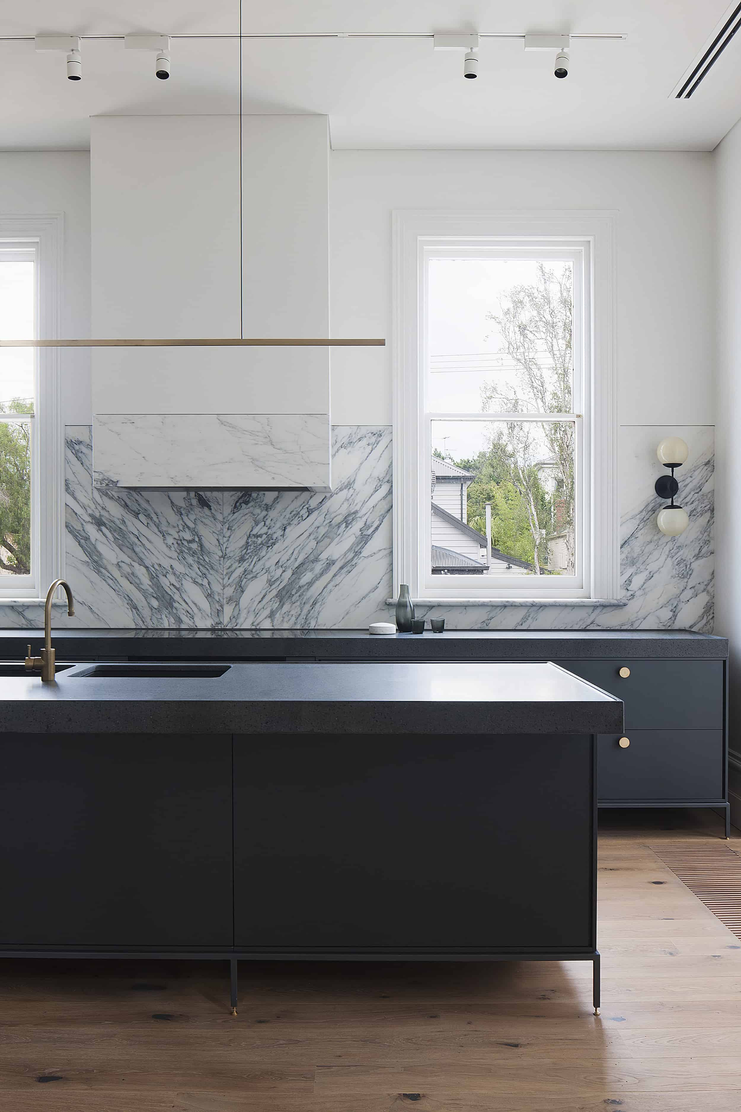 marble backsplash modern kitchen track lighting