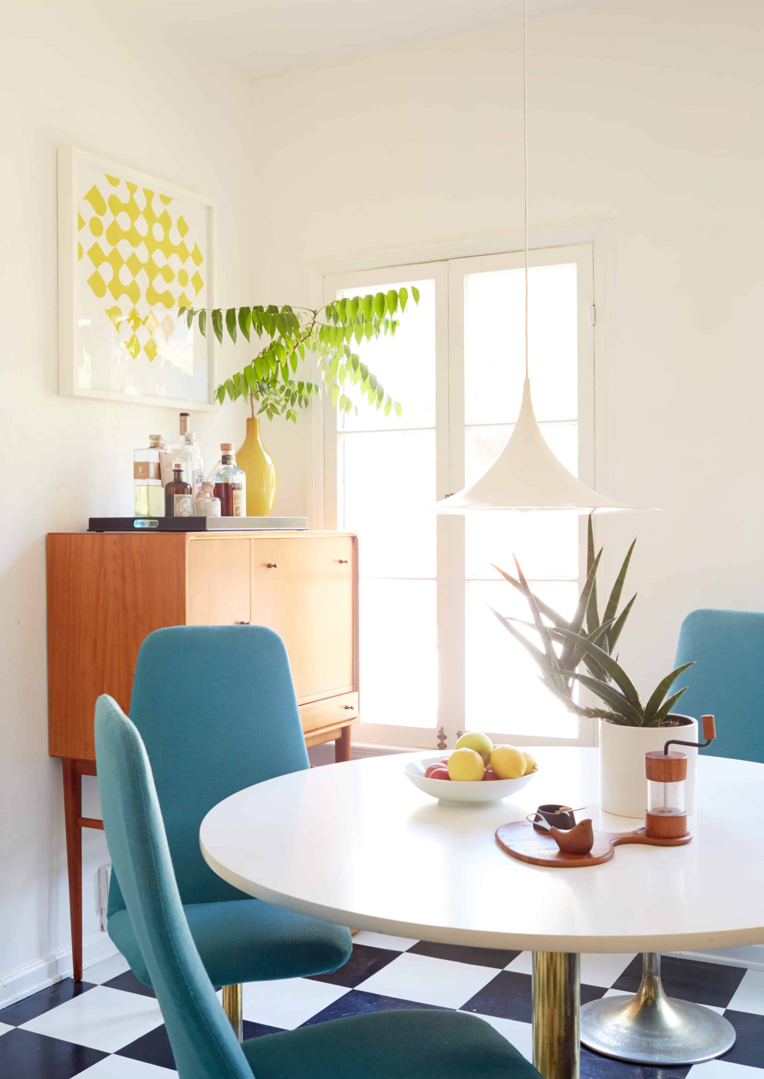 mid century modern dining room turquoise chairs