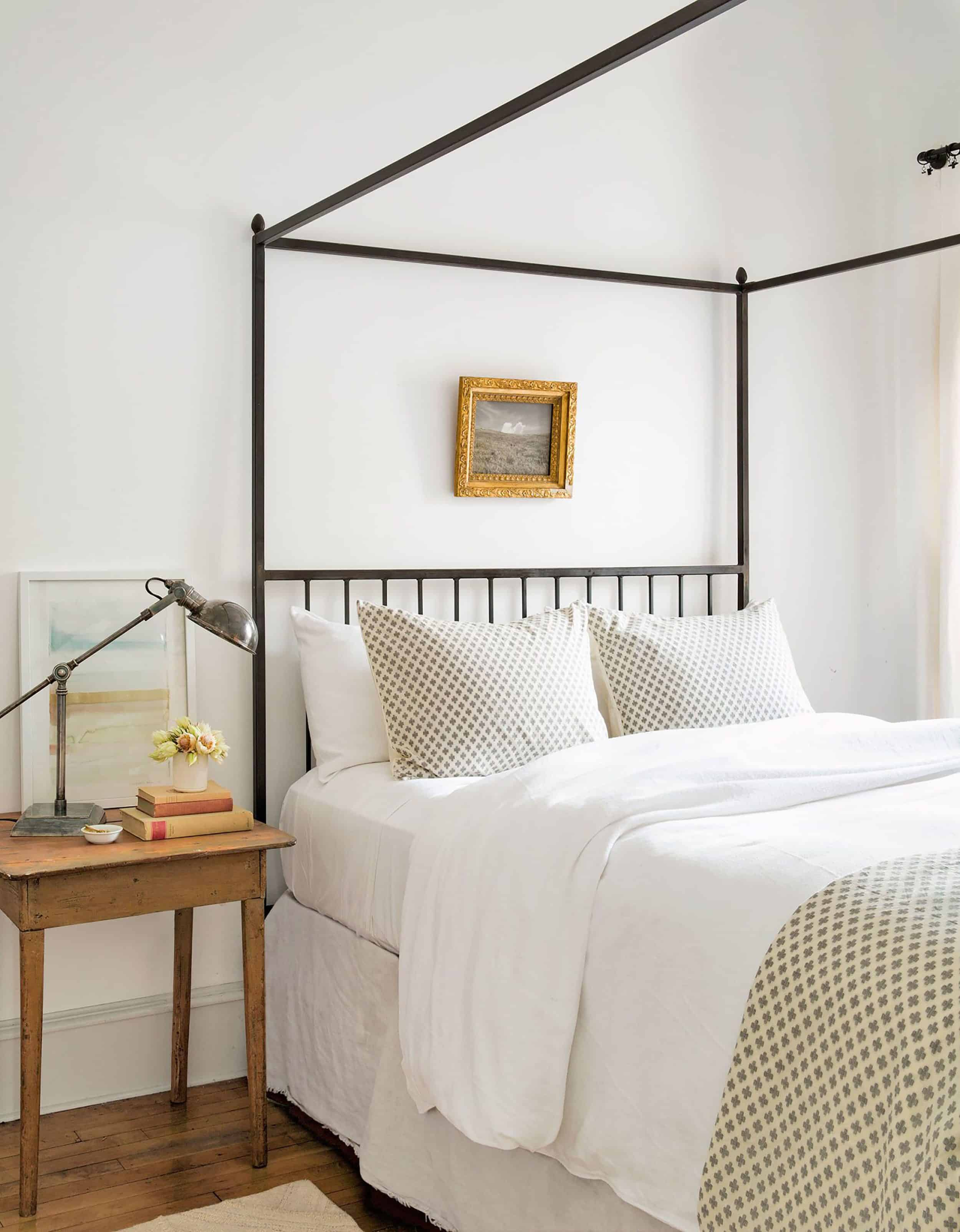 Minimal Farmhouse Bedroom with Iron Four Poster Bed