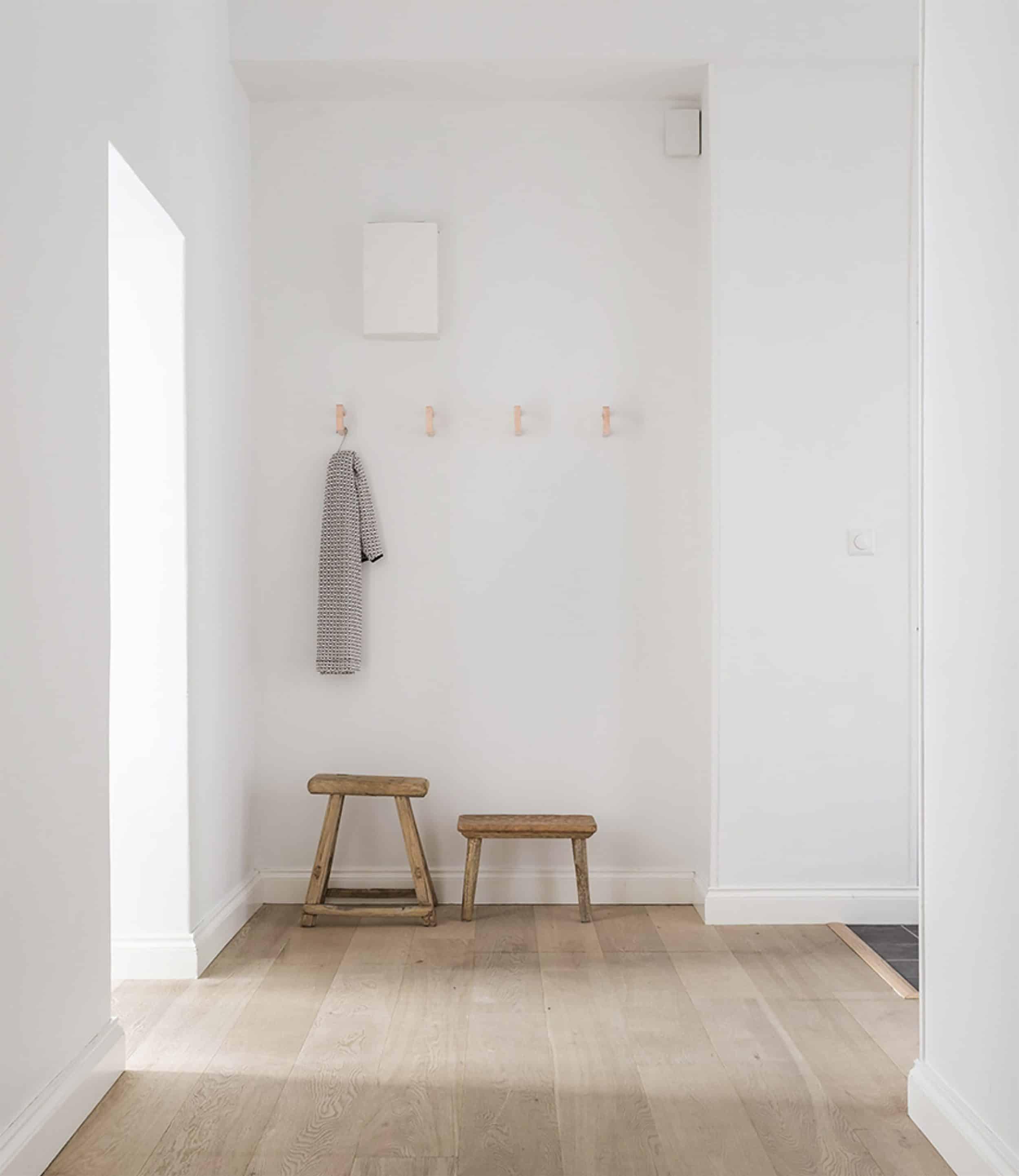 Modern Scandinavian Hallway with Rustic Stools