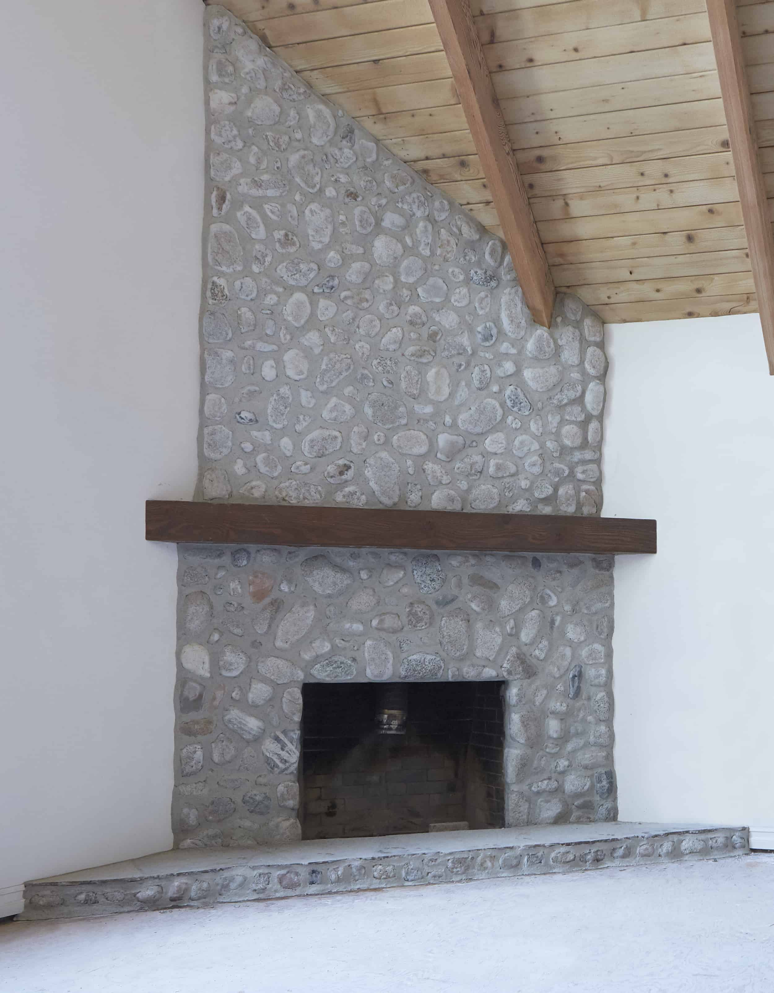Makeover How We Replastered Our Mountain House Stone Fireplace