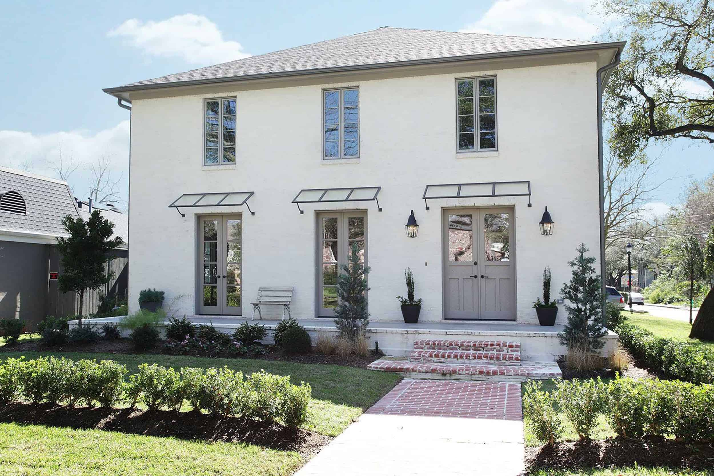 White Home With Light Gray Trim and Door