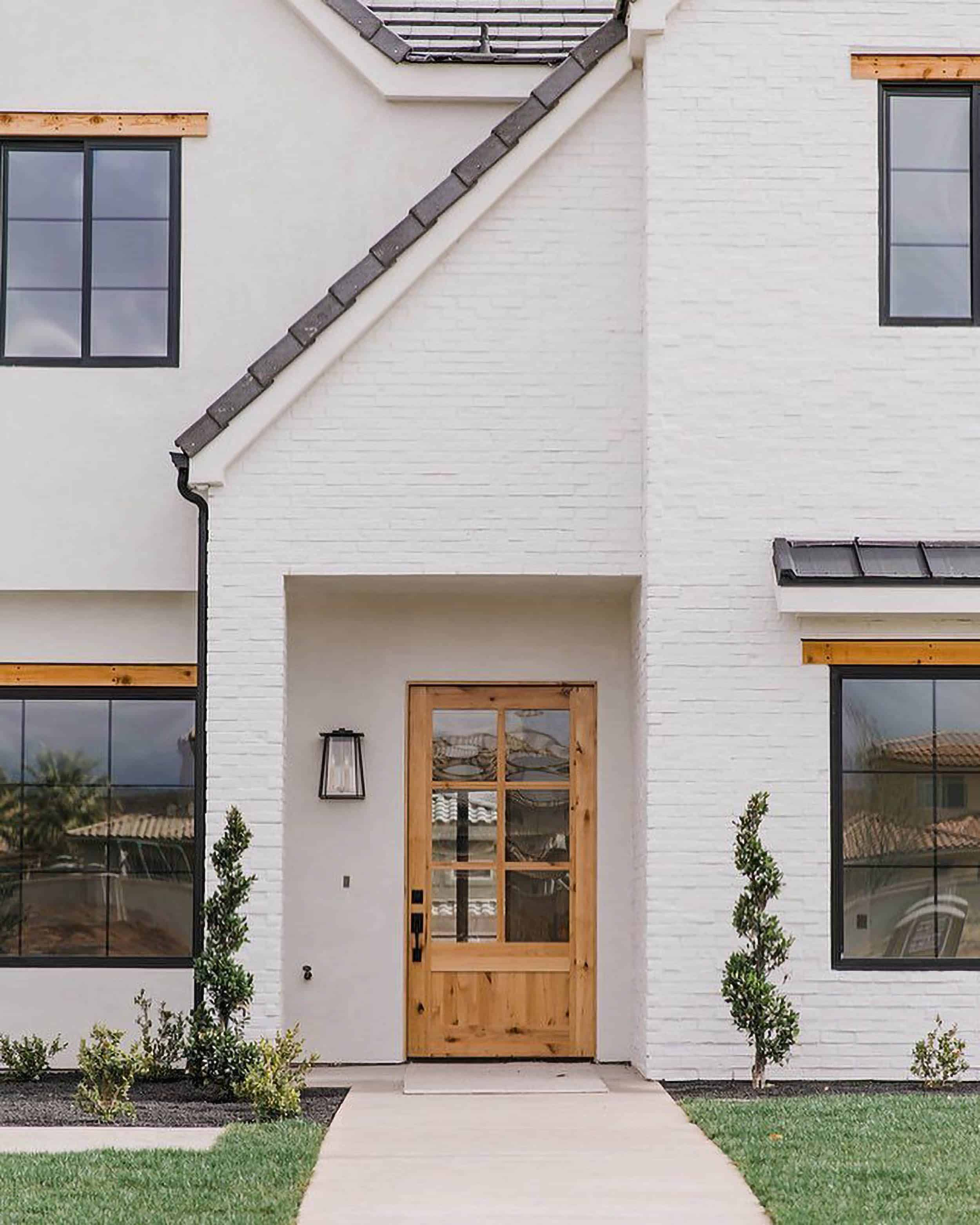 Becki Owens White Brick Home Wood Door