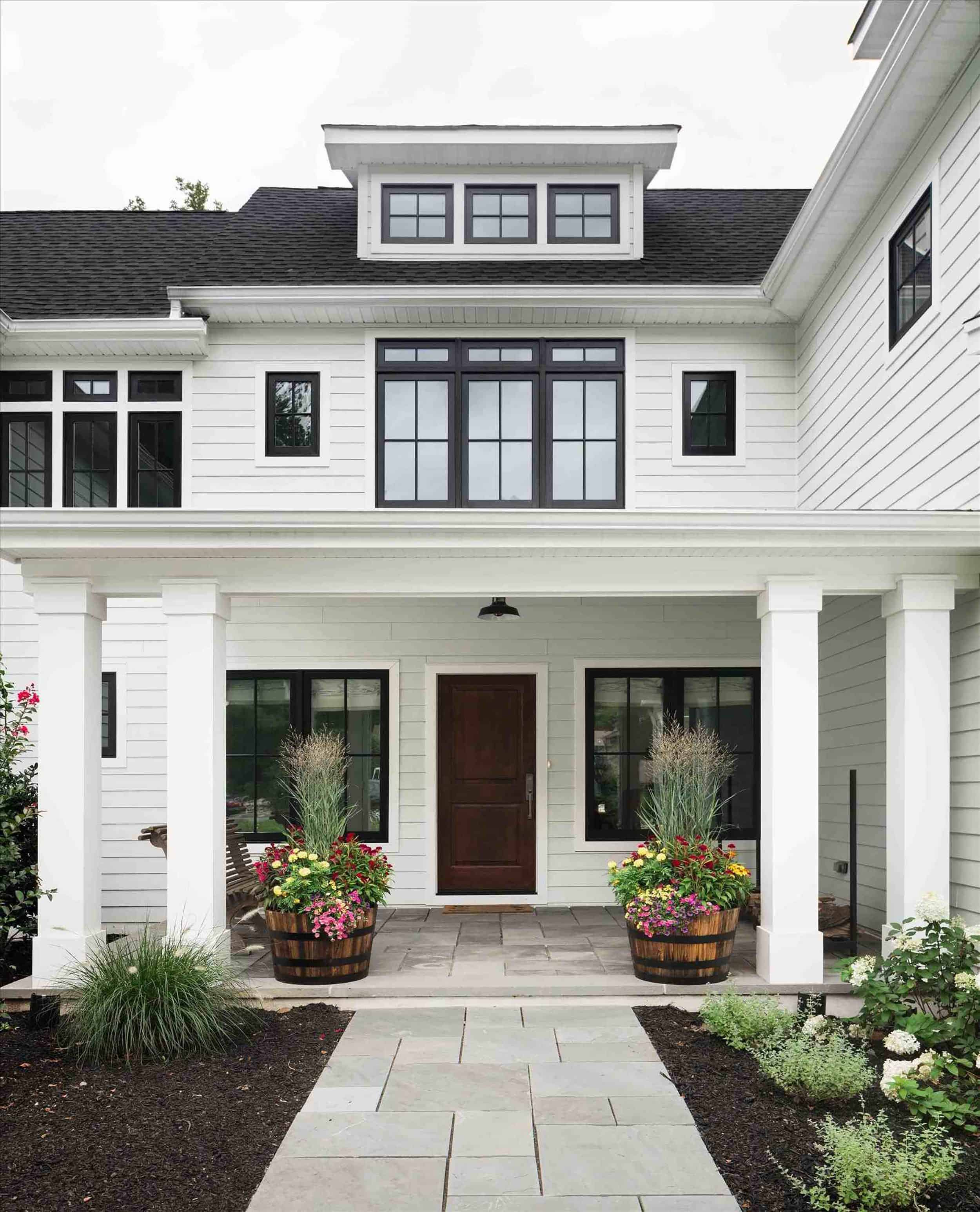 Traditional White Home With Dark Wood Door