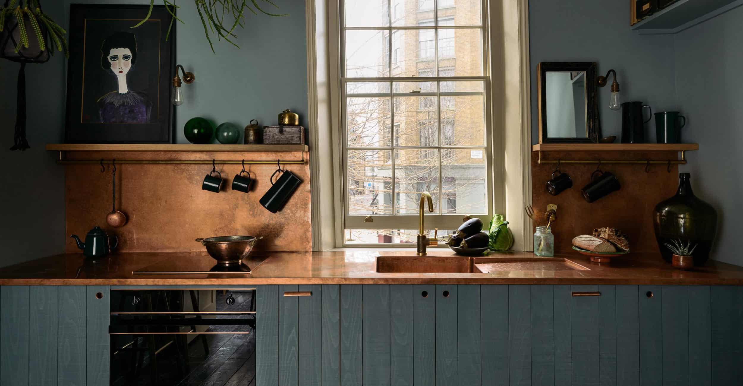 Dark Painted Wood Kitchen Copper Backsplash