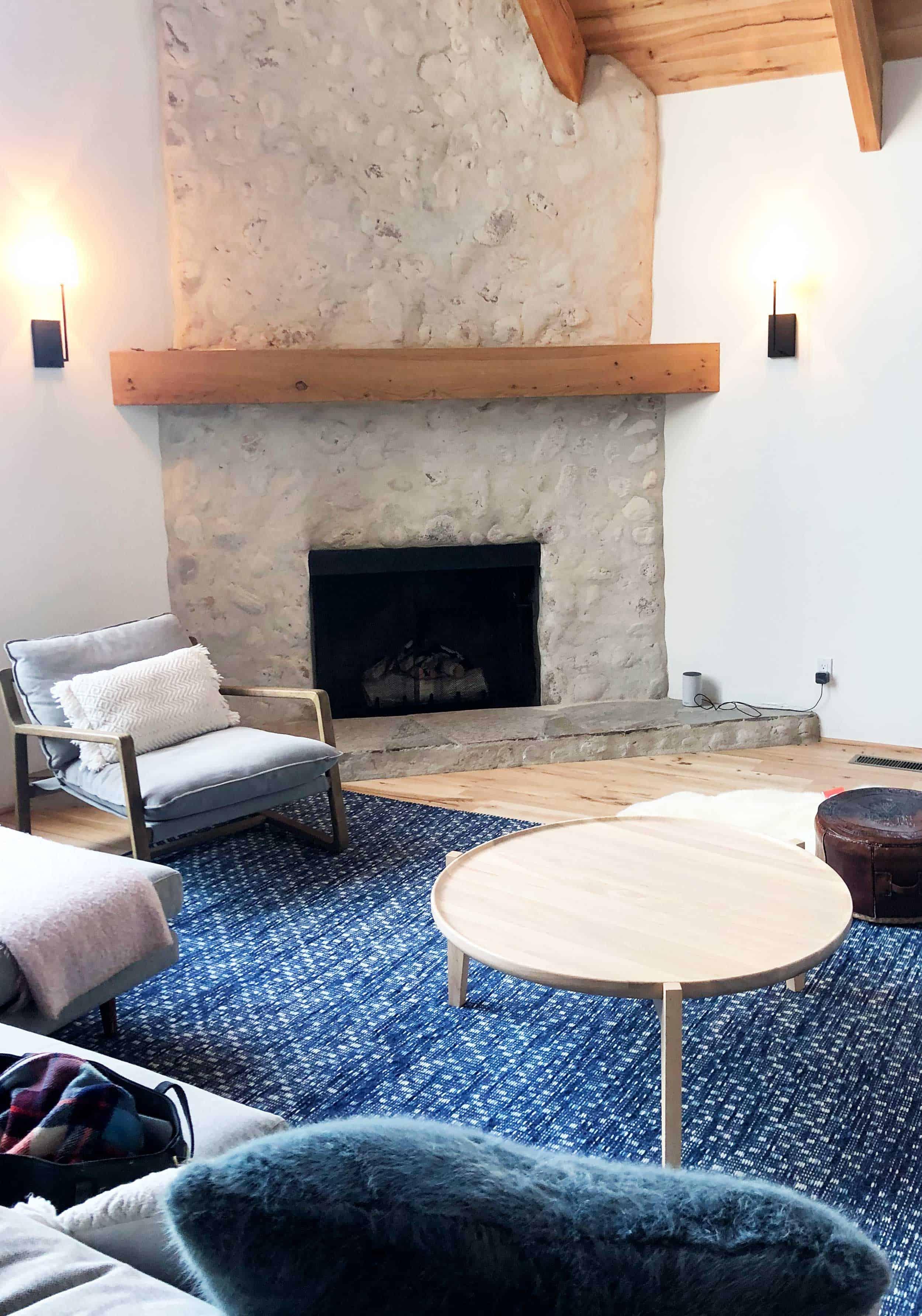 Emily Henderson Mountain House Living Room Rug Stone Fireplace