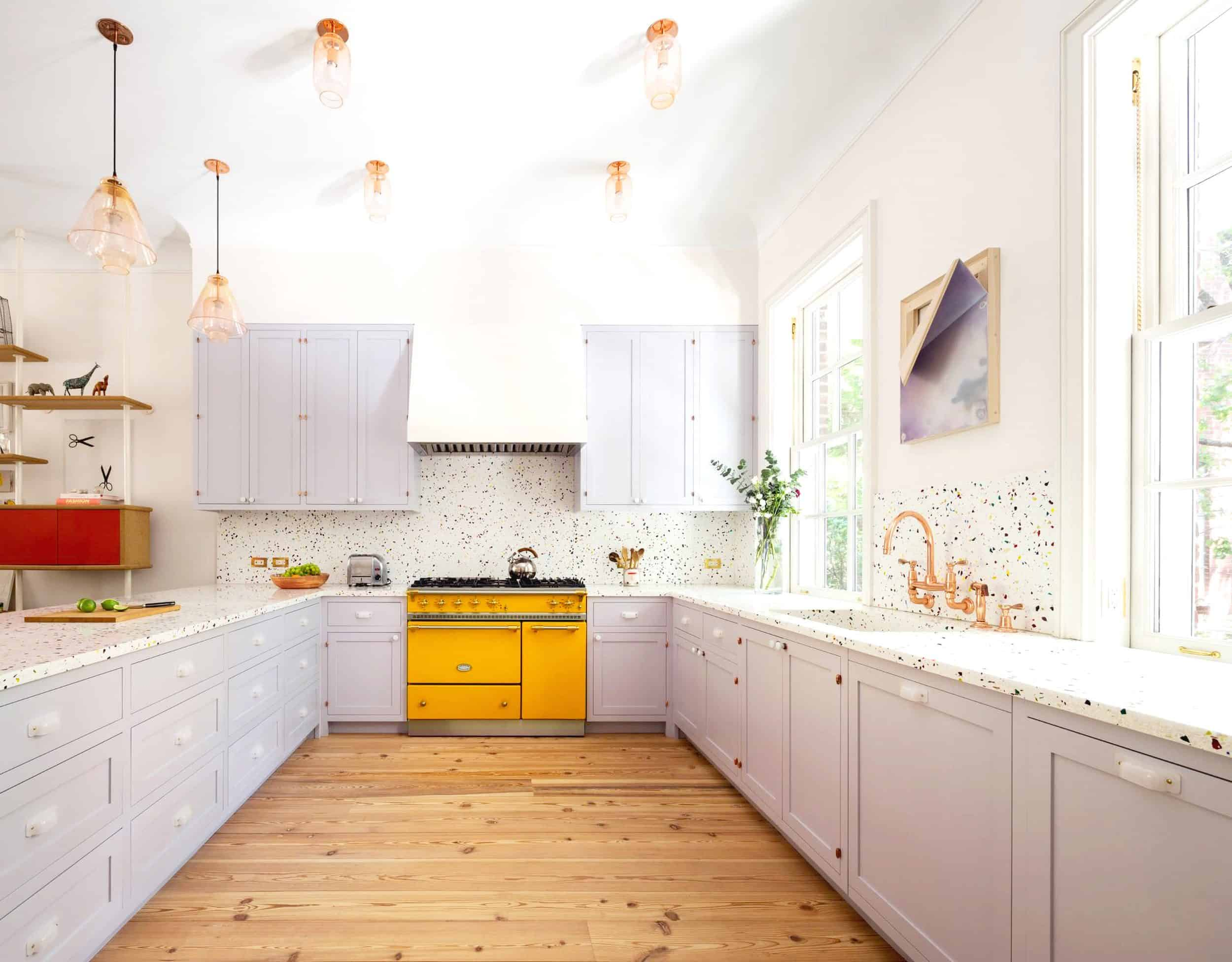22 A Lilac Kitchen Accented With A Bright Yellow Cooker And A Polka Dot Backsplash Plus Brass Lamps