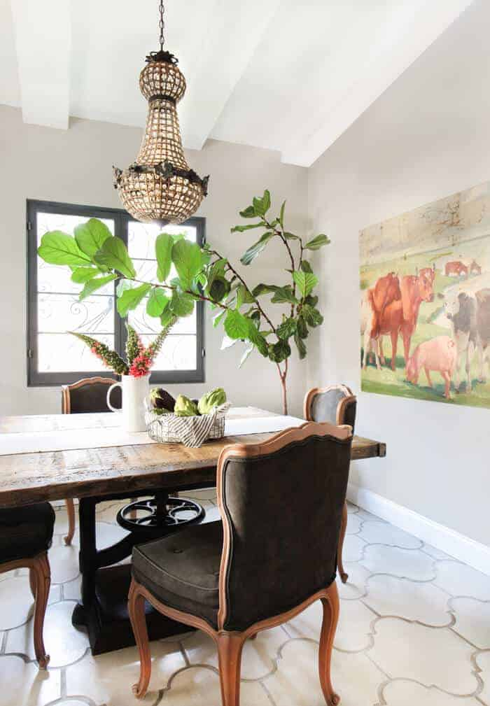 Emily Henderson_French Rustic Dining Room Crystal Chandelier Concrete Tile California Casual_overall with art