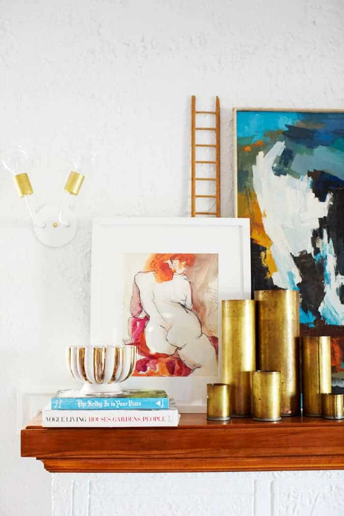 white and brass sconce