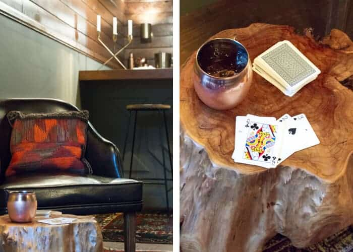 mancave_rustic_cards_moscow_mule_trunk_table_gold_candelabra